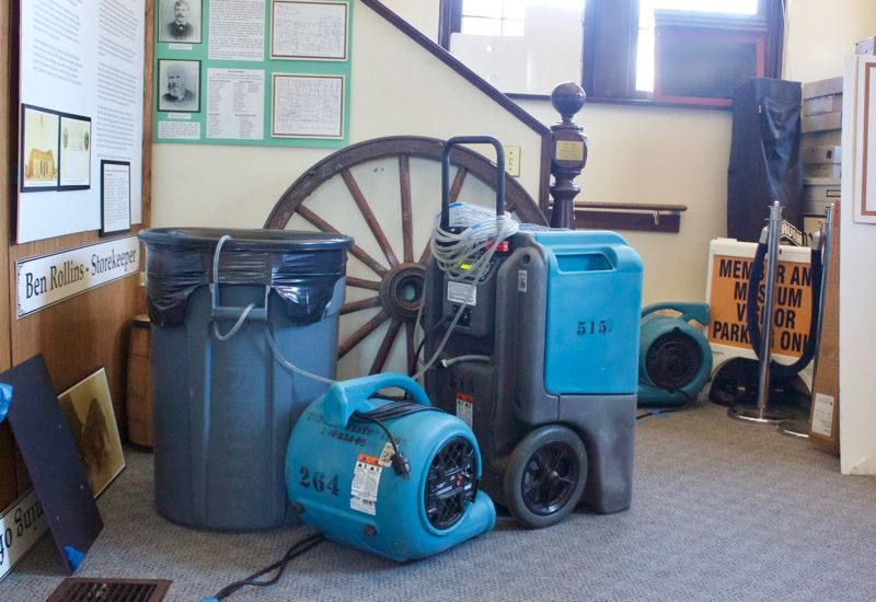 PMG PHOTO: CHRISTOPHER KEIZUR - Ten dehumidifiers are roaring throughout the museum to dry things out after the sprinkler system was set off by a fire.