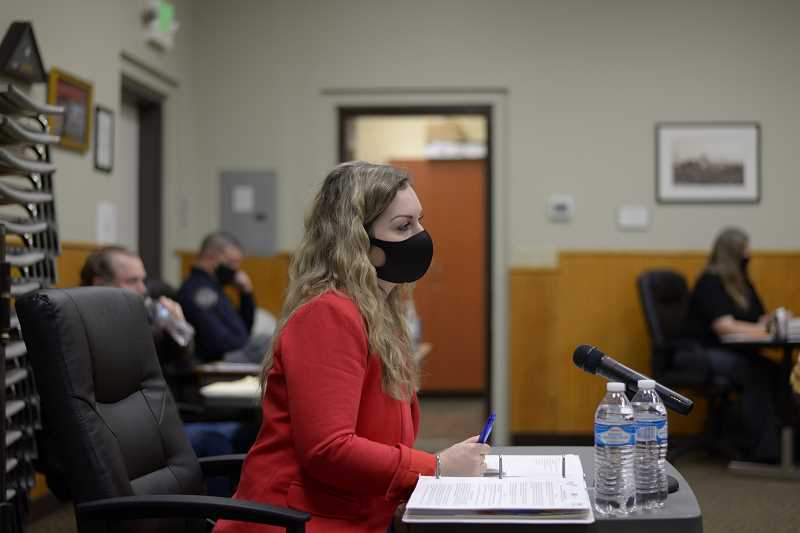 PMG PHOTO: ANNA DEL SAVIO - Interim Scappoose City Manager Alexandra Rains appears at a City Council meeting in January. As city manager, Rains is responsible for the overall city budget.
