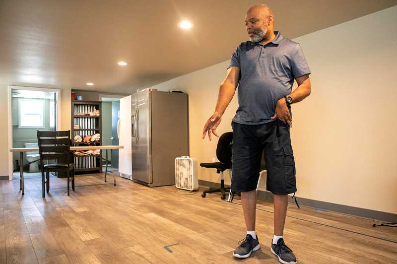 PMG PHOTO: JAIME VALDEZ - Vernon Baker, executive director of Just Compassion, shows where unhoused individuals sleep during extreme weather in the lower level of a renovated home that serves as Just Compassions Resource Center in Tigard.