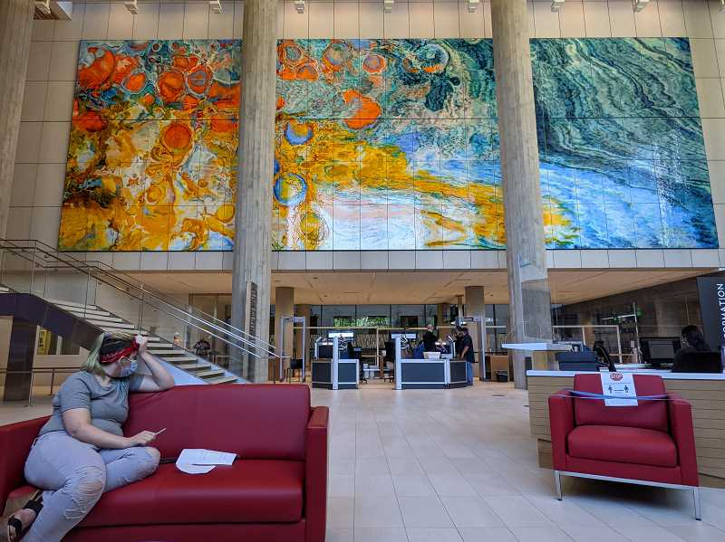 PMG: JOSEPH GALLIVAN - Lyn Basa's mural in the lobby of the new Multnomah County Courthouse. Basa says the movement from bubbling lava on the left to cool water on the right suggests the optimistic view of the criminal justice system, with people moving from hot headedness to cool rationality and maturity over time.