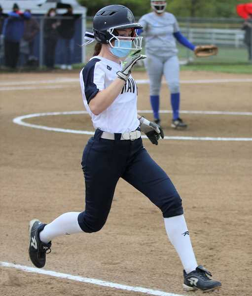 COURTESY PHOTO: STEWART MONROE - Banks' Hailey Frame runs hard to first base during the Braves' home game versus Valley Catholic this past season. Frame was a 4A first team all-state selection for the Braves.