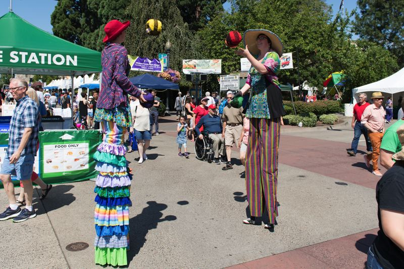PMG FILE PHOTO: CHRISTOPHER OERTELL - Isabel and Matilda Thomas juggle at Celebrate Hillsboro in downtown Hillsboro in 2018.
