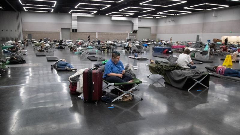 COURTESY PHOTO: MOTOYA NAKAMURA, MULTNOMAH COUNTY  - People shelter inside the Oregon Convention Center during June's historic heat wave. Oregon's heat death toll stands at 116.