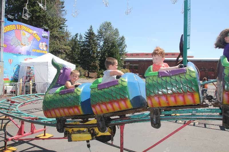 PMG PHOTO: JUSTIN MUCH - The rides were a popular draw at the 2021 Marion County Fair.