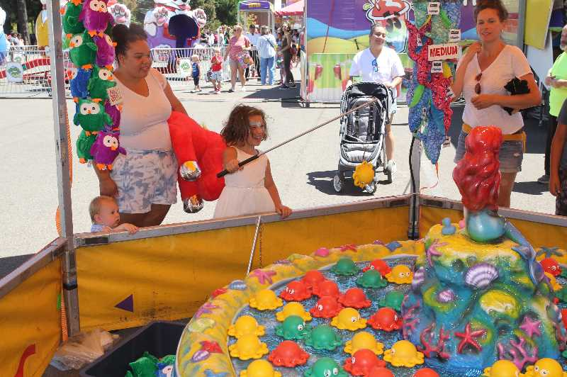 PMG PHOTO: JUSTIN MUCH - Fishing for stuffed animals at the 2021 Marion County Fair.