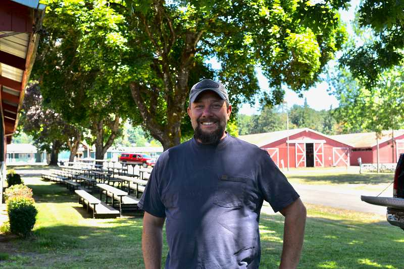 PMG PHOTO: ANNA DEL SAVIO - Columbia County Fair Board President Jamie Carr pauses for a photo on Friday, July 9, as the mostly-volunteer crew runs the annual plant sale and sets up for the county fair and rodeo.