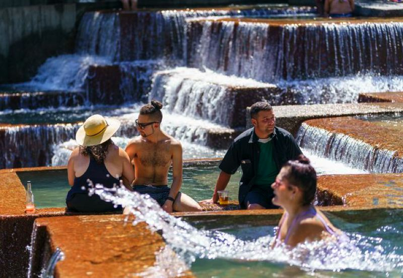 PMG FILE PHOTO - People escaped from the heat in a downtown Portland fountain when temperatures exceeded 110 degrees.