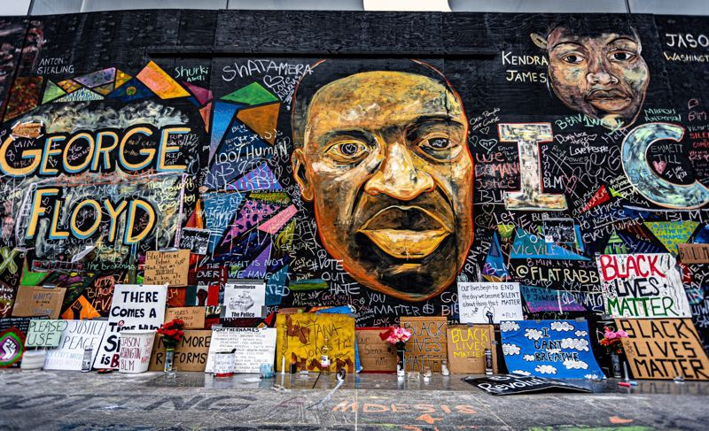 PMG FILE PHOTO - A mural of George Floyd, painted by street artists Steven Brandt and David Flores, was displayed on the Apple store in downtown Portland in 2020.