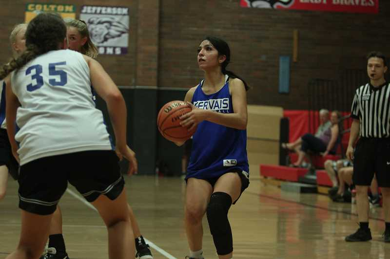 PMG PHOTO: TANNER RUSS - Incoming senior Mayra Perez led the team to a pair of victories against Dayton and Amity on Saturday, July 10 in the Chemawa Summer Classic. Perez will be key in the Cougars quest to reclaim the championship next season.