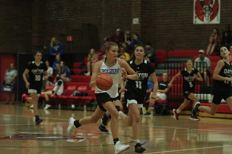 PMG PHOTO: TANNER RUSS - Incoming sophomore Olivia Boyd leads a breakaway down the court against Dayton on July 10 in the Chemawa Summer Classic.