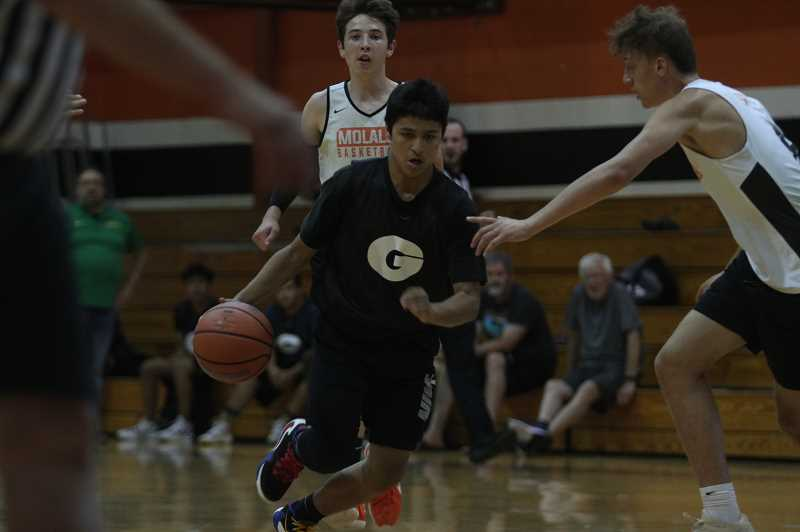 PMG PHOTO: TANNER RUSS - Freshman Gotti Ramon drives to the hoop in a summer league game against 4A Molalla.