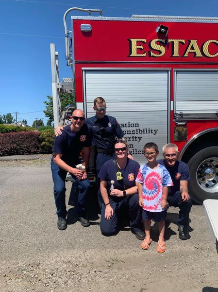 COURTESY PHOTO - Five-year-old Jackson Flock enjoyed meeting the local firefighters who stopped by his lemonade stand on Fourth of July.
