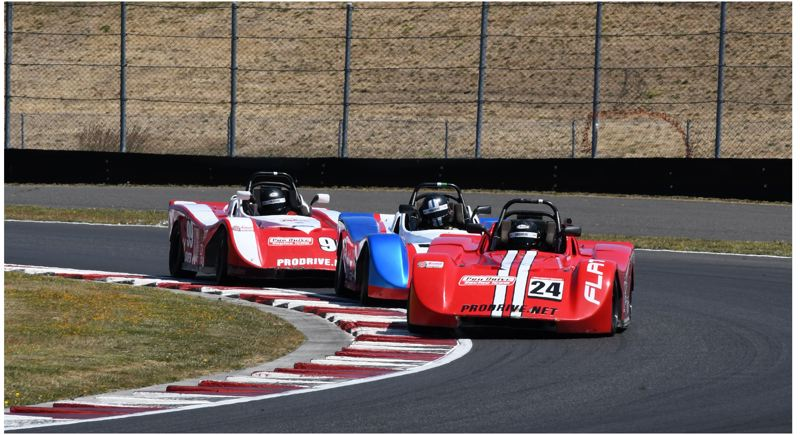 PMG PHOTO: JEFF ZURSCHMEIDE - Todd Harris leads Calvin Harris and Caleb Shrader through a turn in the Spec Racer Ford race on Sunday, July 11 at Portland International Raceway. Calvin Harris won the race ahead of his father, Todd.