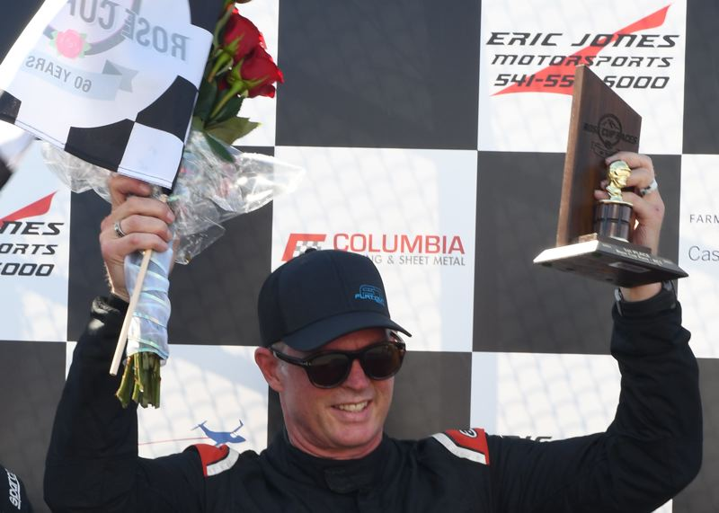 PMG PHOTO: JEFF ZURSCHMEIDE - Phil Fogg Jr. of Aurora celebrates his victory in the 60th Rose Cup Race on July 11 at Portland International Raceway.