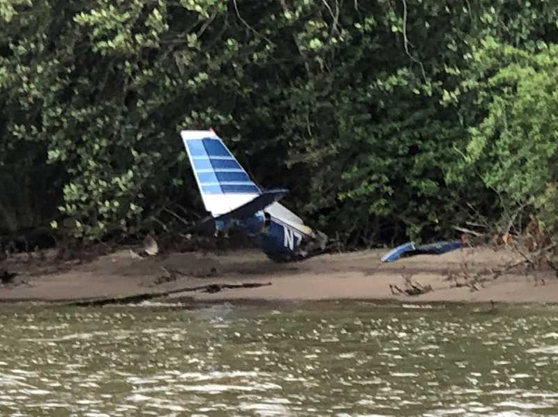 U.S. COAST GUARD PACIFIC NORTHWEST  - Wreckage from a March 2020 crash remains more than a year later.