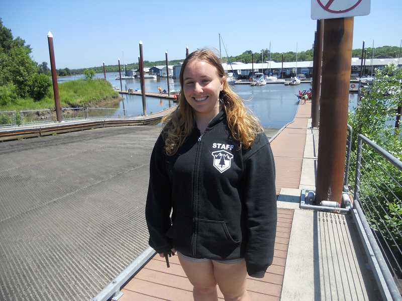 PMG PHOTO: SCOTT KEITH - Carolyne Weiss, a boat handler at Scappoose Bay Marina, enjoys a sunny day.