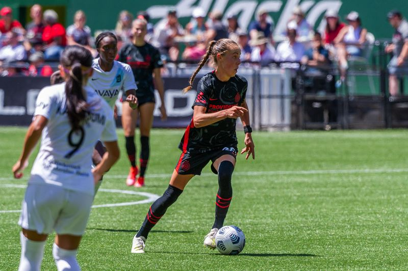 PMG PHOTO: DIEGO G. DIAZ - Midfielder Celeste Boureille's work rate in midfield is one example of how the Portland Thorns' depth is serving the club during Olympic absences.
