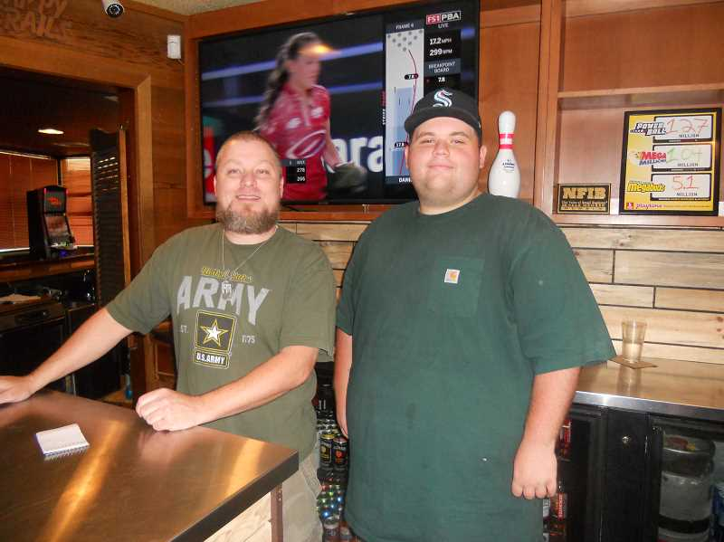 PMG PHOTO: SCOTT KEITH - At Oregon Trail Lanes in St. Helens, Kenny Van-Nostrand (left and Hayden Overstreet run the counter.