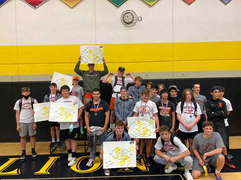 COURTESY PHOTO: SCAPPOOSE WRESTLING - Boys on the Scappoose wrestling team pose with their brackets after the NWOC District Championships.