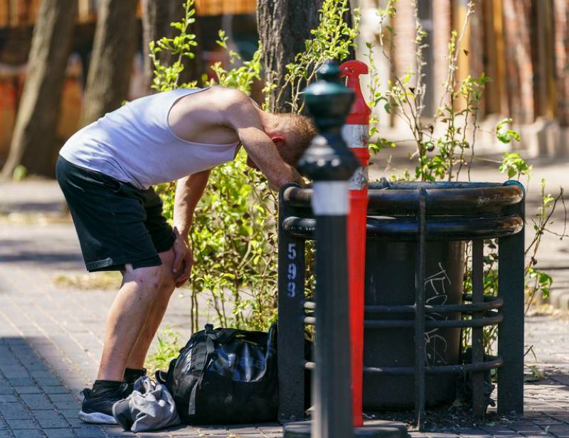 COURTESY PHOTO: OPB - An unidentifed man reels from the excessive heat in late June in Portland.