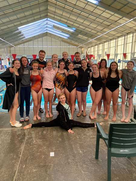 COURTESY PHOTO: DAVID RICHMOND - The Scappoose High School girls team gathers for a photo at a meet., South County Spotlight - Sports Girls team was undefeated, 5-0 ahead of last-minute informal district competition Scappoose girls swim has undefeated dual meet season