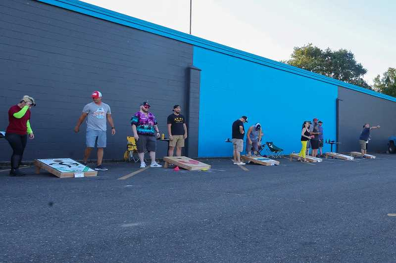 PMG PHOTO: JONATHAN VILLAGOMEZ - The eight-week-long Cornhole tournament is being held at the Oregon Trail Lanes parking lot in St. Helens.