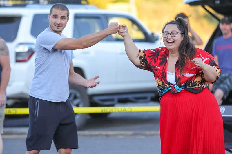 PMG PHOTO: JONATHAN VILLAGOMEZ - Amber McKinnis fist bumps her cornhole opponent after scoring a couple of points on her last turn.