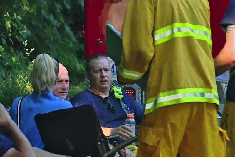 COURTESY PHOTO: KOIN 6 NEWS - Vancouver firefighters get checked for heat exhaustion after battling a 2-alarm house fire during a record-setting heat wave, June 28