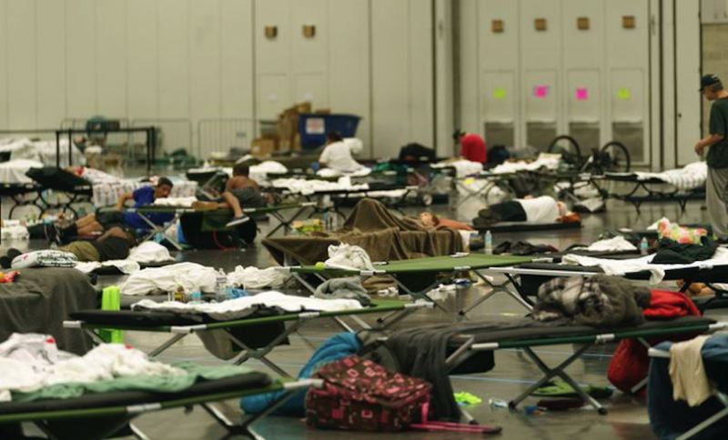 COURTESY PHOTO: KRISTYNA WENTZ-GRAFF, OPB - Hundreds have sought shelter at a cooling center at the Oregon Convention Center in Portland, June 28. The cooling center provided water, snacks, meals, blankets and cots or mats for sleeping.