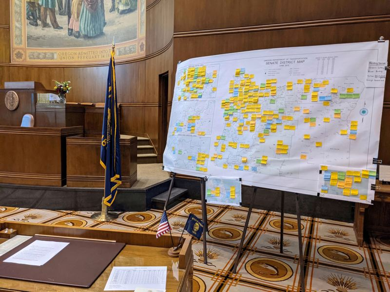 PMG PHOTO: PETER WONG - A map showing where state funds will be spent around Oregon sits in a nearly empty legislative chamber during the final days of the 2021 regular session. On Monday, July 12, the Capitol reopened to the public for the first time in more than 15 months.