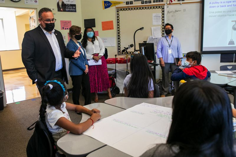 PMG PHOTO: JAIME VALDEZ - U.S. Secretary of Education Miguel Cardona and Rep. Suzanne Bonamici visit with a fourth-grade bilingual summer school class at Witch Hazel Elementary School in Hillsboro on Tuesday, July 13.