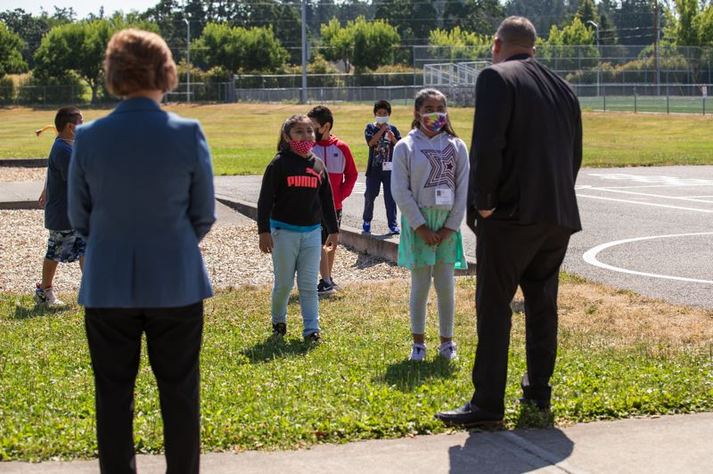 PMG PHOTO: JAIME VALDEZ - U.S. Secretary of Education Miguel Cardona and Rep. Suzanne Bonamici visit with students outside at Witch Hazel Elementary School in Hillsboro.