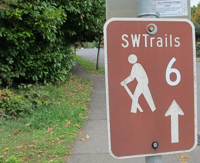 PMG FILE PHOTO - A numbered sign on a trail maintained by SW Trails PDX provides walkers with a guide