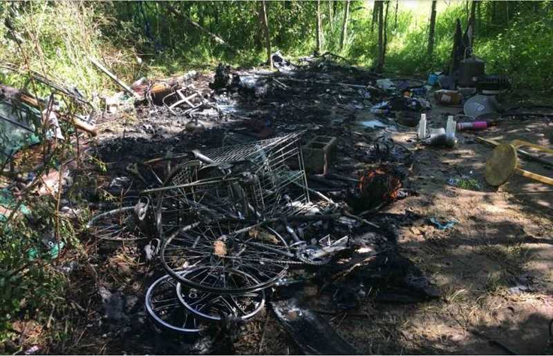 COURTESY PHOTO - Johnson Creek, which runs through Milwaukie, recently fell victim to a propane fire set by illegal campers.