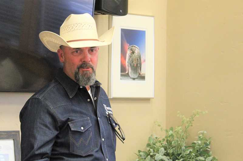PAT KRUIS/MADRAS PIONEER - People know Dave Duquette of Western Justice for his support of Malheur ranchers Dwight and Steven Hammond. He addressed farmers at the North Unit Irrigation District Board meeting Tuesday night, July 13. 'I want to fight these guys. I want to ruin them.'