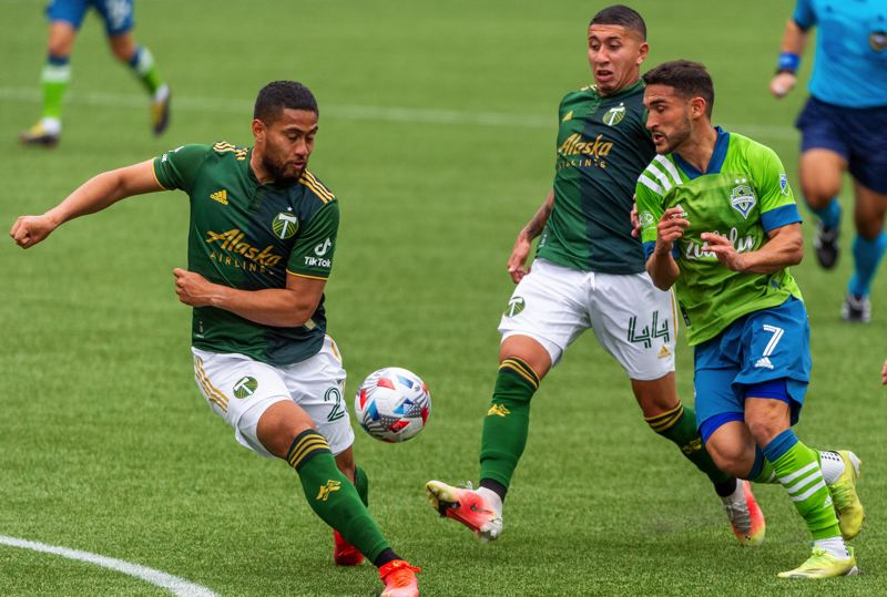 PMG PHOTO: DIEGO G. DIAZ - Portland Timbers defender Bill Tuiloma (left) clears the ball from the path of Seattle's Cristian Roldan in a May 9 match at Providence Park. In his fourth season in Portland, Tuiloma has become a valuable performer for coach Giovanni. Savarese.