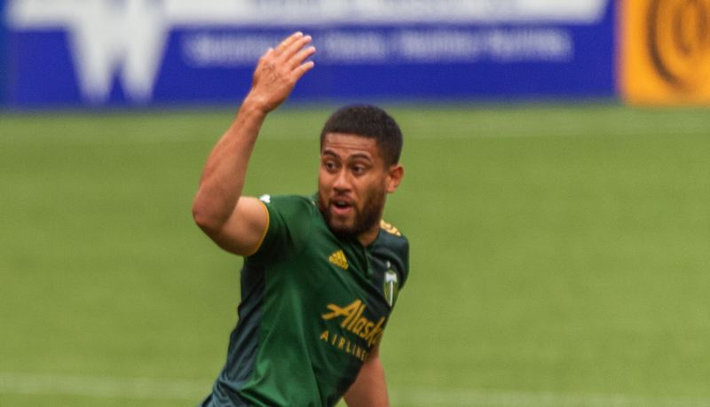 PMG PHOTO: DIEGO G. DIAZ - Bill Tuiloma encourages his Timbers teammates back into position after Tuiloma scored a late goal in a May 9 match against the Seattle Sounders at Providence Park.