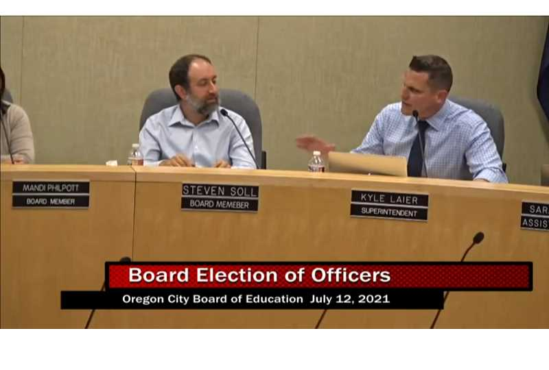 PMG SCREENSHOT: RAYMOND RENDLEMAN - Oregon City Interim Superintendent Kyle Laier (right) speaks after the school board chose to demote Steven Soll from his previous position as vice-chair on July 12.