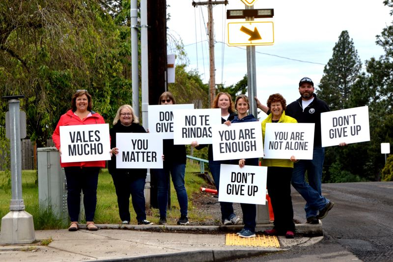 PMG PHOTO: CINDY FAMA - Team members from Clackamas County Behavioral Health Division hold Signs of Hope for mental health awareness in 2019. Two Oregon lawmakers say it is time to change the funding priorities in behavioral health.