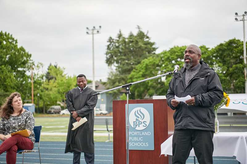 PHOTO COURTESY PORTLAND PUBLIC SCHOOLS - Gary Hollands addresses a crowd during a swearing-in ceremony July 1 for new members of the Portland Public Schools Board of Education. Hollands is serving his first term on the school board.