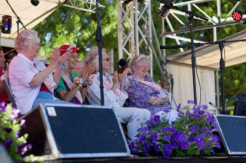 PMG PHOTO: ANNA DEL SAVIO - The other court members clap as Renee Swartz, right, is introduced at the My Fair Lady pageant on July 14, 2021.