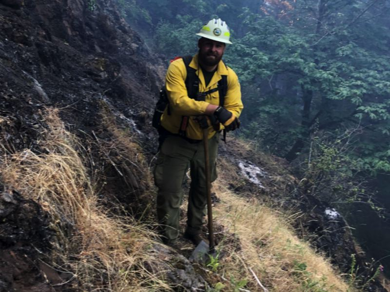 COURTESY PHOTO: OREGON DEPARTMENT OF FORESTRY - Dillon Neumann, a state firefighter with the Oregon Department of Forestry, scouts steep terrain near the Game Hog Creek Fire.