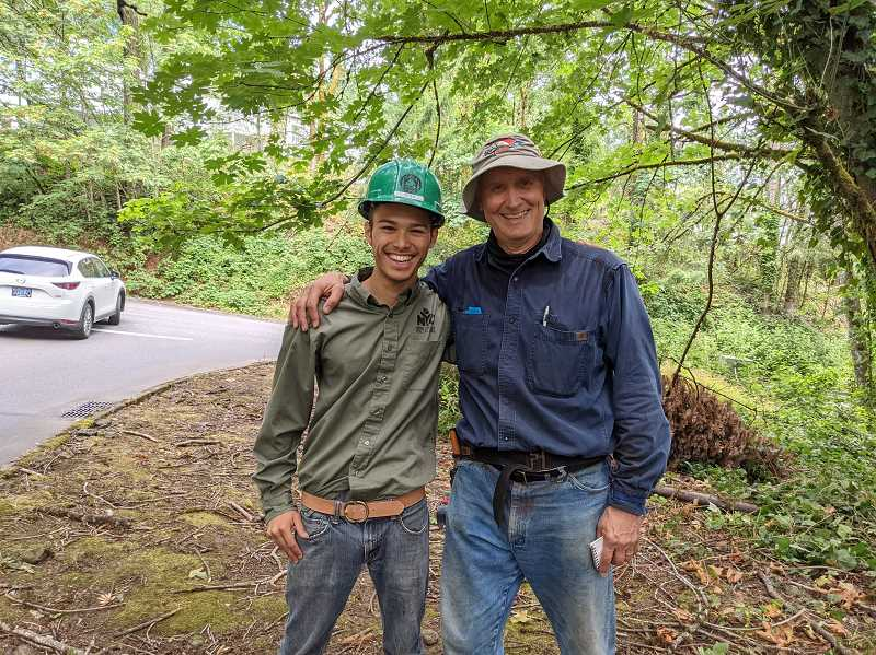 COURTESY PHOTO: ABBY FARBER - Peter Reidy (left) and David Kleinke worked with Reidy's team of high schoolers from the Northwest Youth Corps to clear invasive species from West Linn greenspaces.