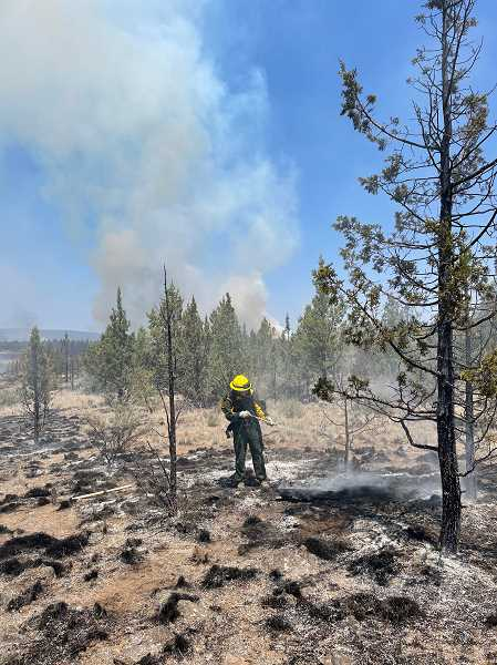CENTRAL OREGON FIRE INFO PHOTO - Crews conduct a wet mop up of the Grandview Fire.