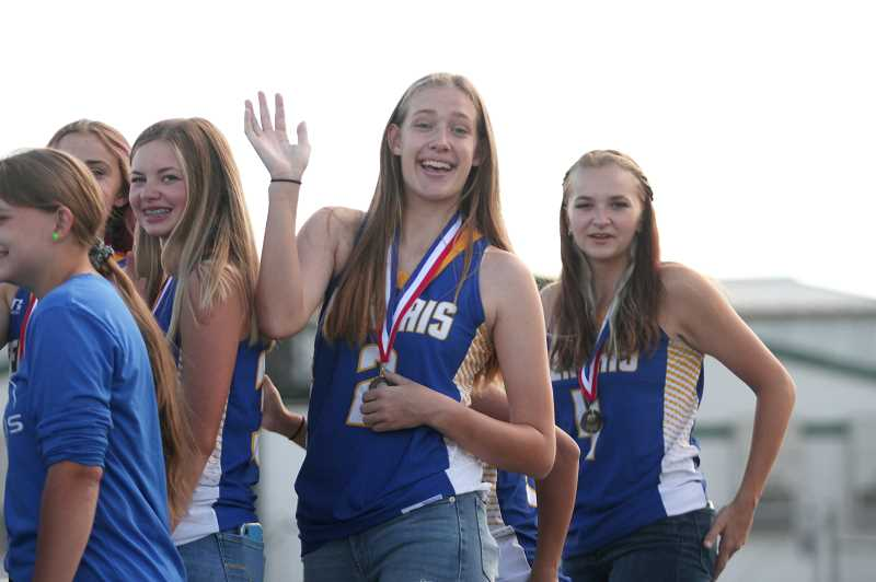 PMG PHOTO: PHIL HAWKINS - Gervais' Josie Schultz is bracketed by teammates Ava Sellers (left) and Izzy Boyd (right), representing part of the incoming sophomore class eager to take the reins from the departing seniors and defend the championship trophy.