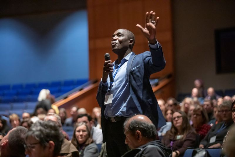 PMG PHOTO: JONATHAN HOUSE - Massene Mboup asks a question to Marvin Lynn during the Multi-City Equity Summit hosted by the cities of Lake Oswego, Tigard, Tualatin, West Linn, and Wilsonville.