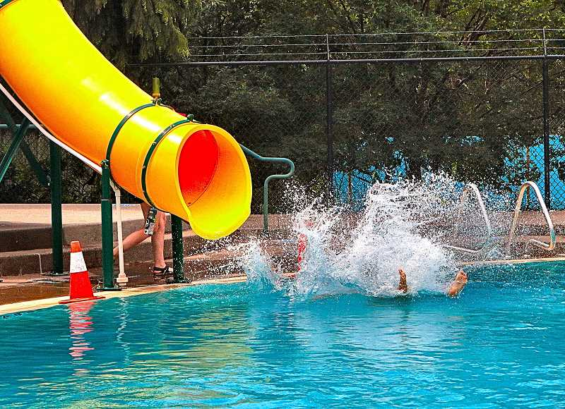 DAVID F. ASHTON - A favorite feature of the Sellwood Pool is the water slide!