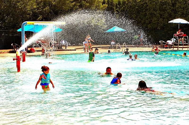 DAVID F. ASHTON - After a full year of its being closed, cool summer fun returned to the historic Sellwood Pool on June 22nd.