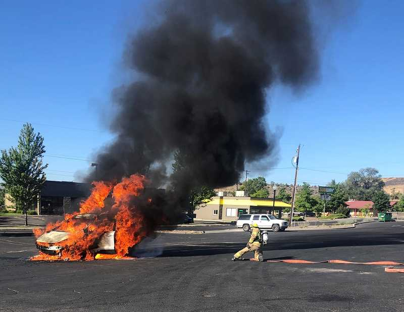 PHOTO COURTESY OF JCFD NO. 1 - Jefferson County Fire District No. 1 extinguishes a car fire on Sunday with no injuries and no further damage. Fire fighters do not know what caused the fire.
