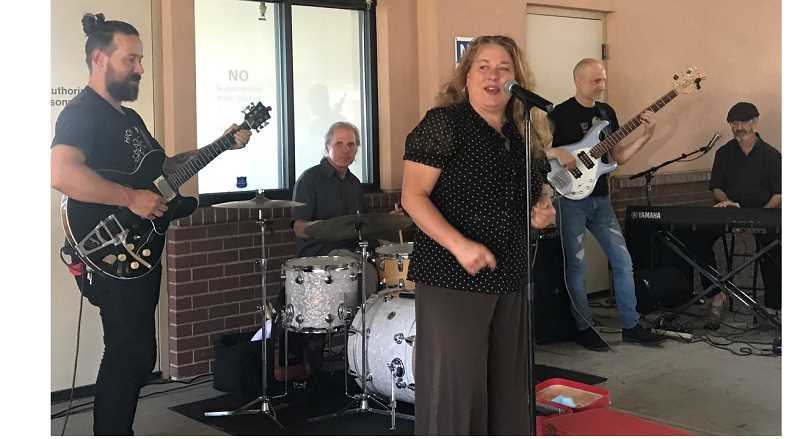PMG PHOTO: LAURA CANIDA - Blues and gospel band members who donated their time and talent for free at the NAMI event included Kivett Bender on guitar, Scott Van Dusen on drums, Ken Brewer on keys, Willy Barber on bass and Rae Gordon on vocals.